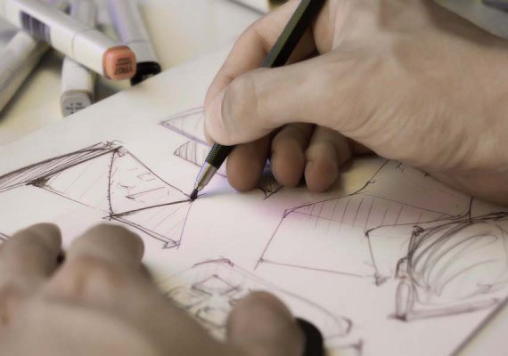 Concept Development Innovation Image - Designer Sketching Idea