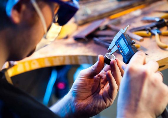 Production Sustaining Engineering Image - Engineer using slide gauge