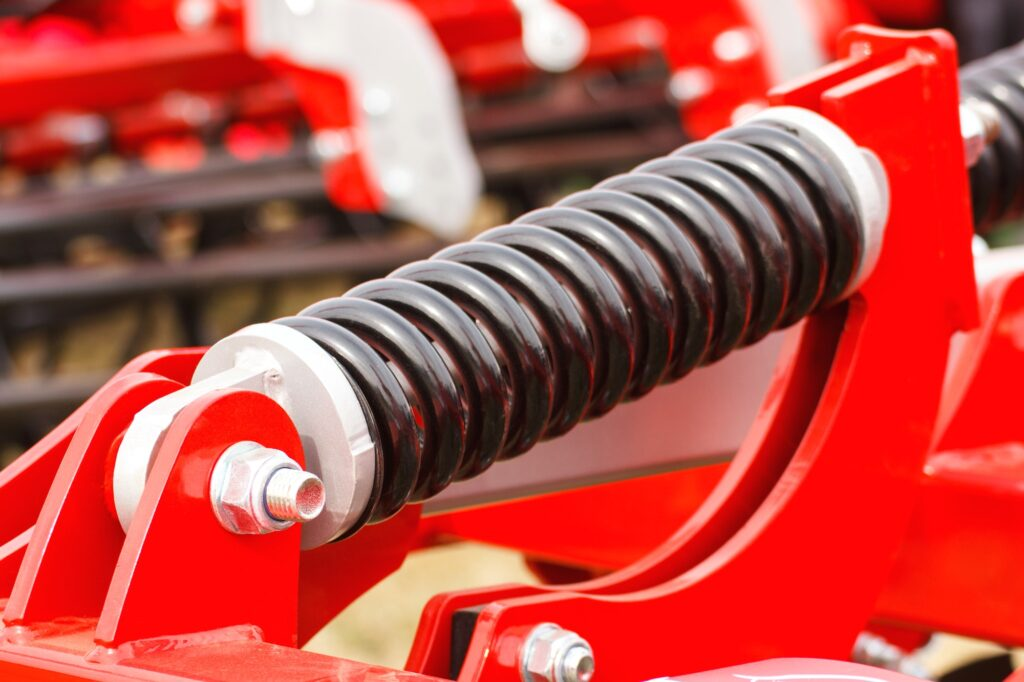 Steel spring on industrial or agricultural machinery, technology and engineering